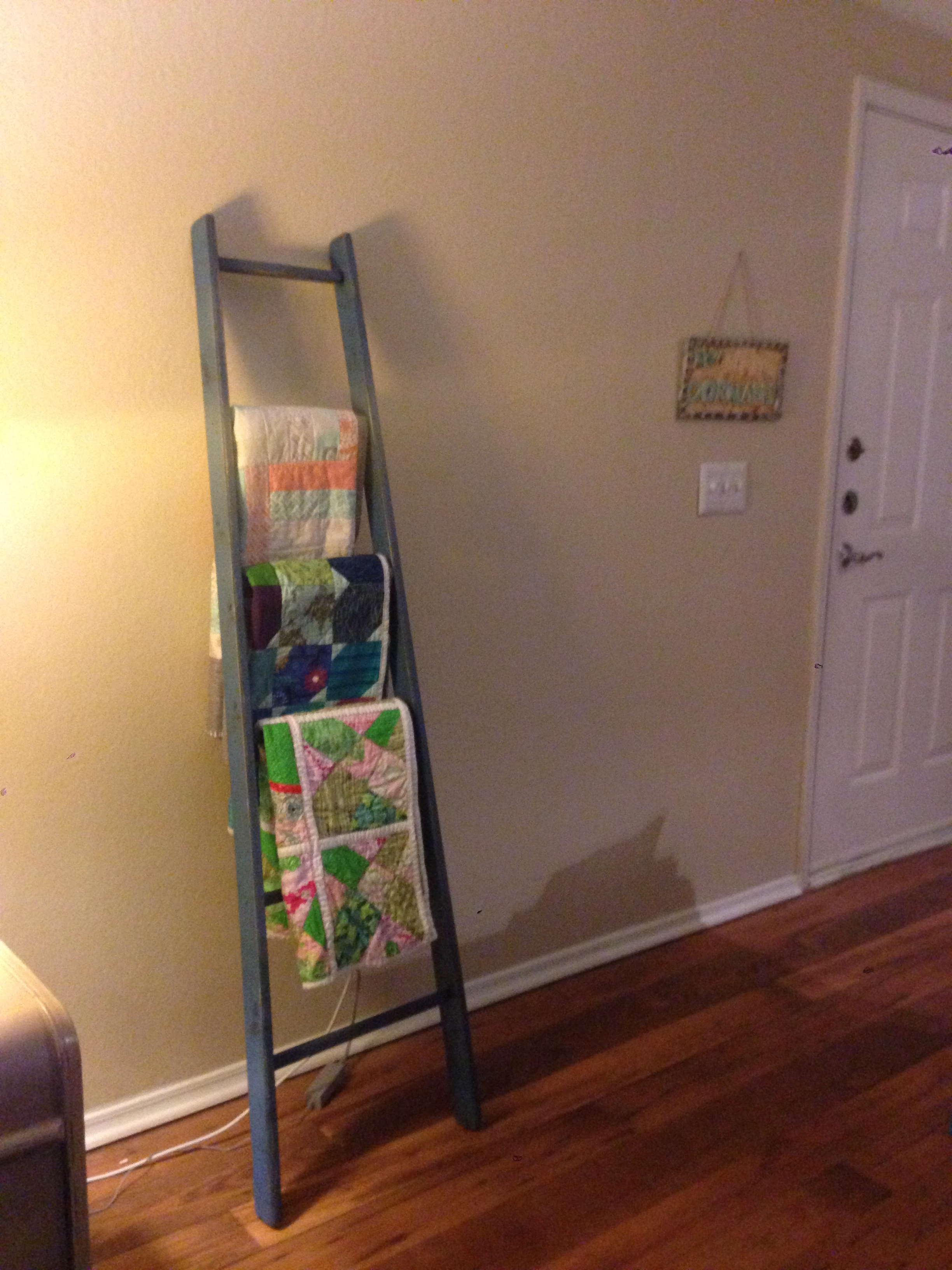 Project pinterest quilt ladder the amateur librarian for Living room quilt