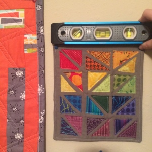 The Amateur Librarian // Use a Level to Hang Mini Quilts